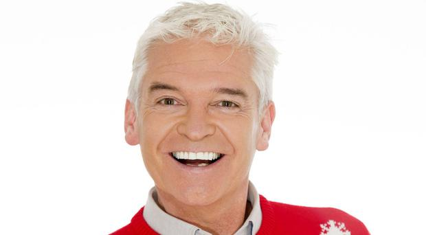 Philip Schofield wearing a Christmas jumper as part of ITV's Text Santa appeal (ITV/PA)