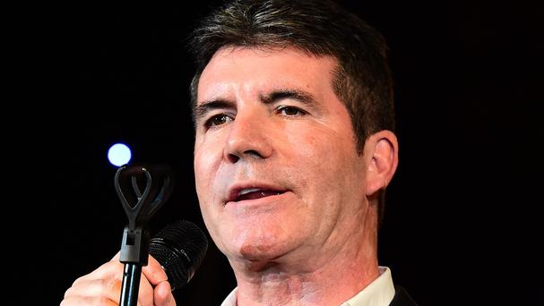 Simon Cowell was reportedly at home during the break-in