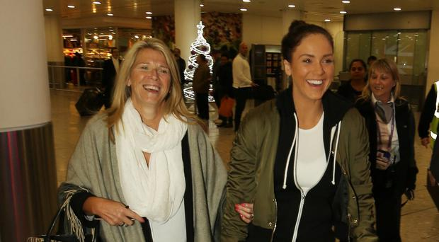 Vicky Pattison walks through Heathrow Airport with her mother Caroll after arriving back from Australia