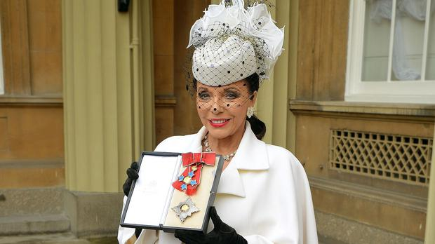 Dame Joan Collins in her investiture outfit that fetched more than £16,000 at a US auction