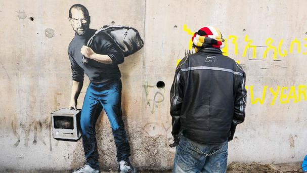 The Banksy mural depicting Steve Jobs at The Jungle in Calais