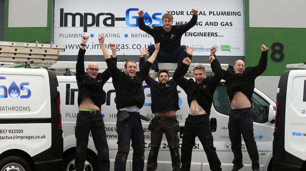 Staff at Impra-Gas celebrate after their boss Joseph Valente won BBC1's The Apprentice