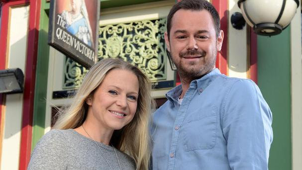 Mick (Danny Dyer) surprises Linda (Kellie Bright) with a touching Christmas present (BBC/PA)