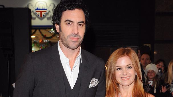 Sacha Baron Cohen and Isla Fisher have given a million dollars to charity