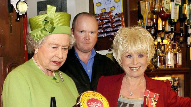 The Queen pictured with Barbara Windsor during a 2001 visit to the EastEnders set at Elstree Studios. Barbara Windsor is recognised for services to charity and entertainment
