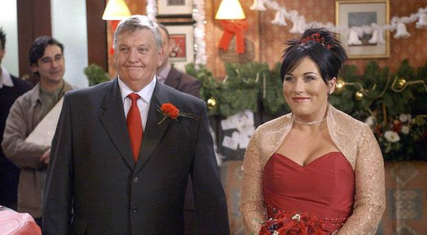 Charlie Slater, played by Derek Martin, seen with Jessie Wallace as Kat Slater during her wedding at the Queen Vic to Alfie Moon