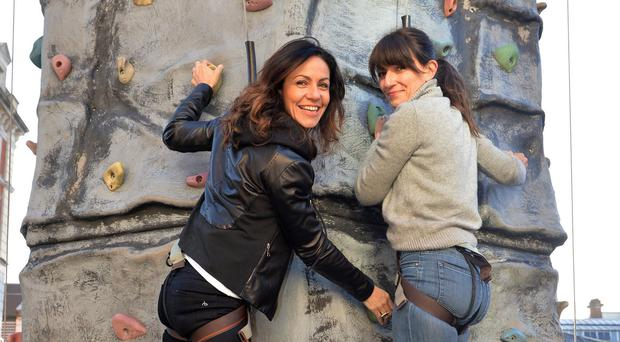 Julia Bradbury and Davina McCall pose on a climbing wall in Covent Garden, London to launch a project marking the 60th anniversary of the Duke of Edinburgh's Award scheme