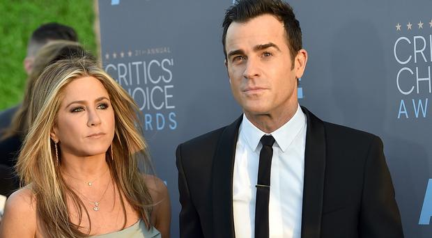 Jennifer Aniston and Justin Theroux arrive at the Critics' Choice Awards in Santa Monica (Invision/AP)