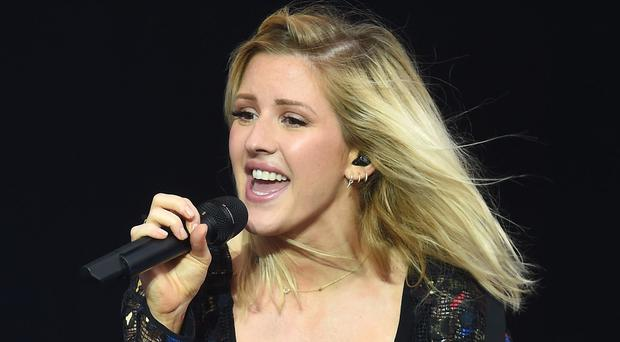 Ellie Goulding and a photographer had to escape through the roof of their vehicle after it went through the ice on a lake in Norway