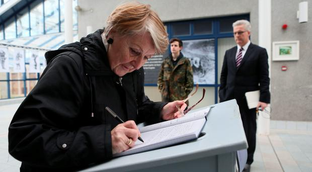 Members of the public sign the book of condolence at Limerick Town Hall following the death of Limerick-born Sir Terry Wogan