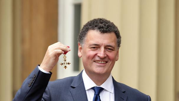 Screenwriter Steven Moffat at Buckingham Palace after being made an OBE