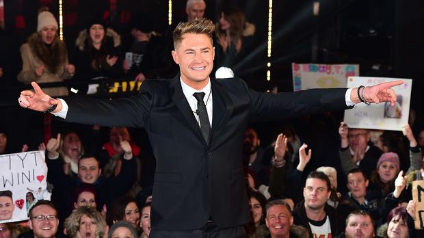 Scotty T leaves the Celebrity Big Brother house in triumph after he was declared the winner during the final of the show