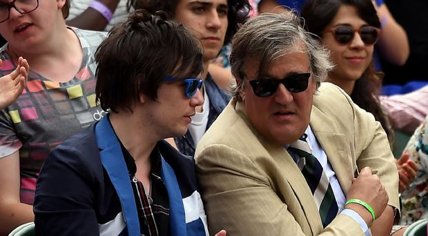 Stephen Fry says he and Elliott Spencer are moving to Hollywood for several months to work on a pre-arranged project
