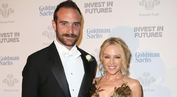 Joshua Sasse and Kylie Minogue pictured attending a reception for the Prince's Trust Invest in Futures Gala Dinner in London