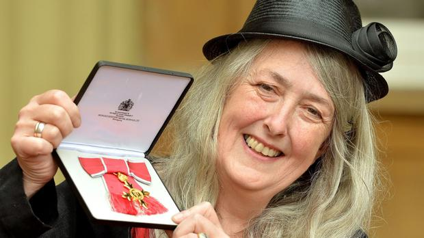 Professor Mary Beard shows off her OBE in 2013