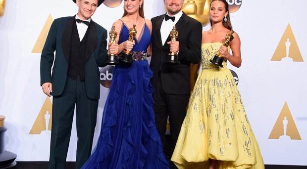Stars Mark Rylance, Brie Larson, Leonardo DiCaprio and Alicia Vikander show off their Oscars after the Academy Awards in Hollywood on Sunday evening