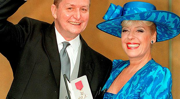Tony Warren, the creator of Coronation Street, with actress Julie Goodyear outside Buckingham Palace after he received an MBE from the Queen in 1994
