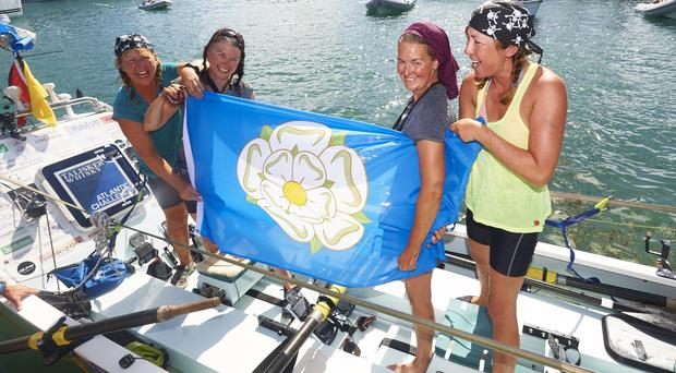 The Yorkshire Rows team of Janette Benaddi, Frances Davies, Niki Doeg and Helen Butters, who set a new world record as the oldest all-female crew to row across an ocean (Talisker Whisky Atlantic Challenge/PA)