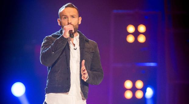 The Voice contestant Kevin Simm made it to the knockout stage after being saved by coach Ricky Wilson (BBC)
