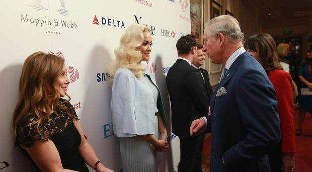 The Prince of Wales meets Rita Ora during the Prince's Trust Celebrate Success Awards at the London Palladium