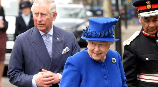 The Queen and the Prince of Wales arrive at the Prince's Trust Centre in Kennington, London