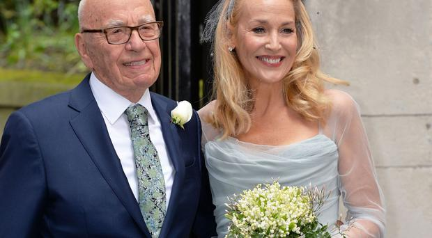 Rupert Murdoch and Jerry Hall outside St Bride's Church in London after a ceremony to celebrate their marriage
