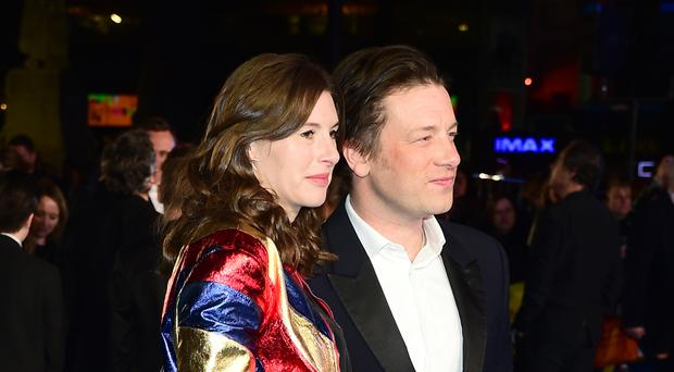 Jamie Oliver with wife Jools, whose baby bump set tongues wagging at the Eddie The Eagle premiere in London