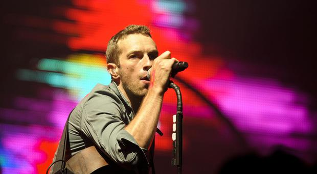 Chris Martin, of Coldplay, said he and Gwyneth Paltrow remain friends