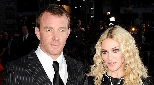 Guy Ritchie and Madonna are embroiled in separate litigation in England and New York