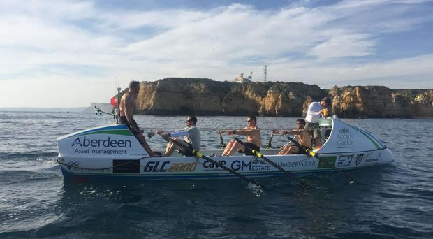 Oliver Bailey, Jason Fox, Mathew Bennett, Aldo Kane and Ross Johnson who have completed their Atlantic Ocean rowing challenge (Team Essence/PA)