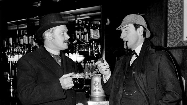 Douglas Wilmer (right) as Sherlock Holmes