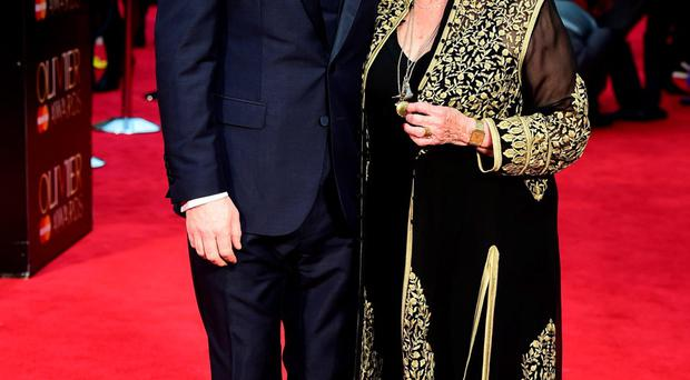 Dame Judi Dench with Sir Kenneth Branagh on the Olivier Awards red carpet last night