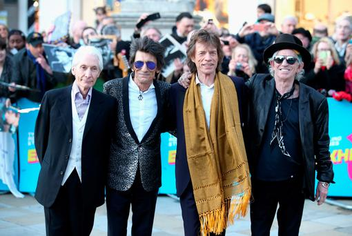 Charlie Watts, Ronnie Wood, Mick Jagger and Keith Richards arrive for the private view of The Rolling Stones: Exhibitionism at the Saatchi Gallery in London yesterday. (Photo by Chris Jackson/Getty Images)