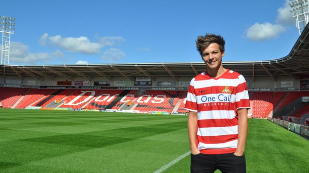 One Direction singer Louis Tomlinson at Doncaster Rovers FC (Doncaster Rovers FC/PA)