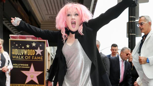 Cyndi Lauper attends a ceremony honouring her with a star on the Hollywood Walk of Fame (AP)