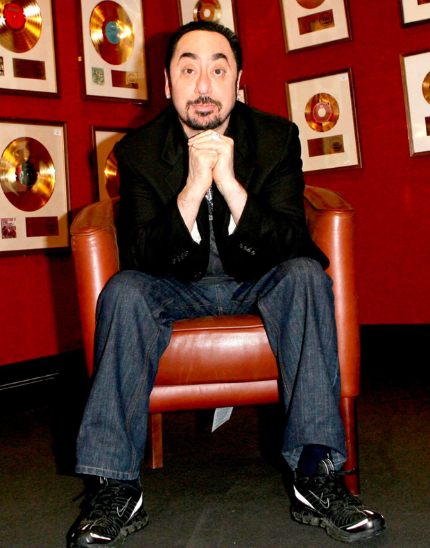 Music producer and reality TV star David Gest with some of his gold records