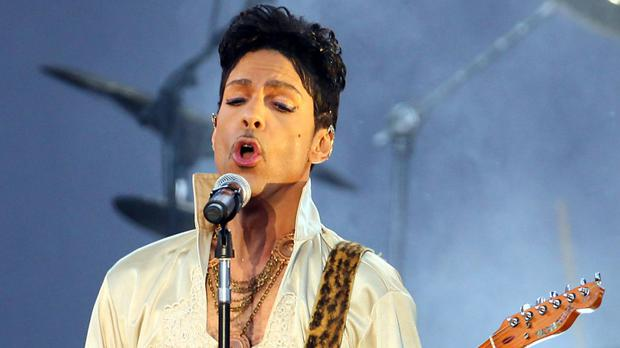 Prince seen performing at the Hop Farm Festival in Kent - the superstar had been fighting flu for several weeks