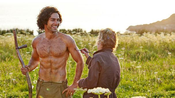 Irish heart-throb Aidan Turner said the mania surrounding the image of him holding a scythe in Poldark was 'very strange' (BBC/PA)