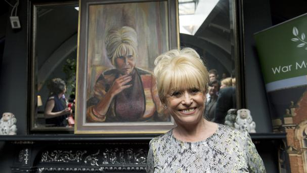 Dame Barbara Windsor with the portrait by Welsh artist Dan Llywelyn Hall
