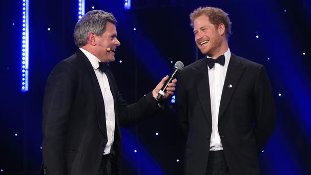 Prince Harry (right) speaks to host Mark Durden-Smith on stage at the BT Sport Industry Awards 2016 at Battersea Evolution, in London.
