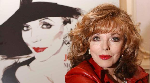 Joan Collins said Madonna's sons might well be embarrassed by their mother's choice of outfit