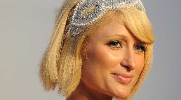 Paris Hilton is among the celebrities to have posed with primates
