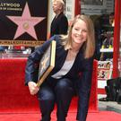 Jodie Foster poses by her star at her Hollywood Walk of Fame (Invision/AP)