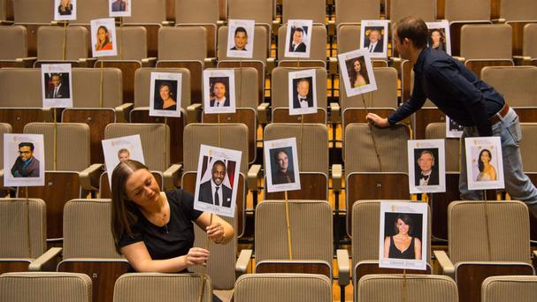 Bafta staff adjust heads on sticks showing the seating plan for nominees and guests at the awards ceremony