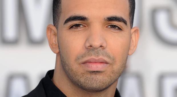 Drake has a number one album and single and a new UK streaming record