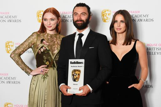 Eleanor Tomlinson, Aidan Turner and Heida Reed accepting the Radio Times Bafta Audience Award for Poldark