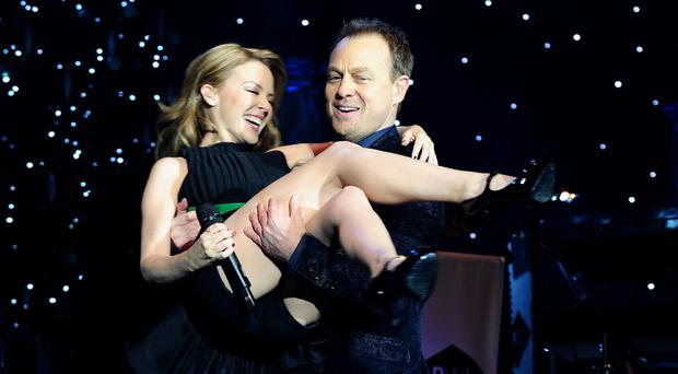 Kylie Minogue and Jason Donovan perform at the Hit Factory Live Christmas Cracker concert at the O2 arena in London in 2013