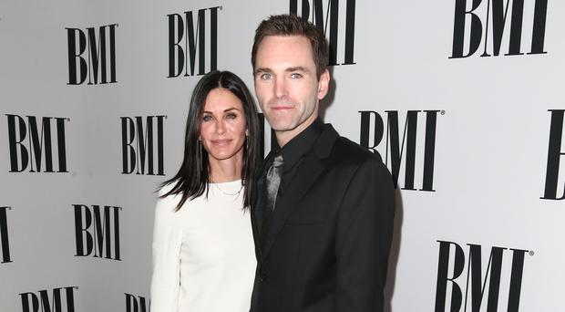 Courteney Cox with Johnny McDaid at the 64th annual BMI Pop Awards (John Salangsang/Invision/AP)