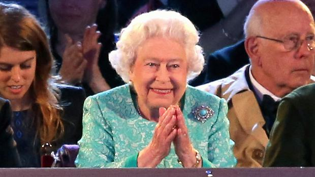The Queen watches her 90th birthday celebration in the grounds of Windsor Castle