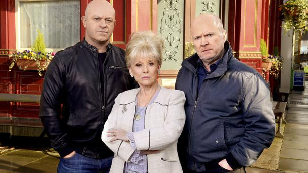 Peggy Mitchell (Dame Barbara Windsor) with on-screen sons Grant and Phil (BBC/PA)